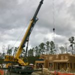 Crofton Crane Rental & Riggin's 80-ton sets roof trusses.