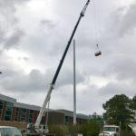 Crofton Crane Rental & Rigging's 90-ton Link-Belt repairs telecommunications tower.