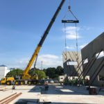 Crofton Crane Rental & Rigging's 300-ton Grove places tilt up panels in Chesapeake, VA.