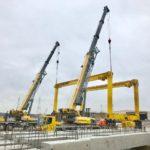 Crofton Crane Rental & Rigging's 90-ton and 110-ton hydraulic truck cranes perform tandem lift.