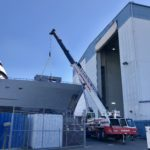 Crofton Crane Rental & Rigging's 90-ton Link-Belt placing a crane boom back on the ship