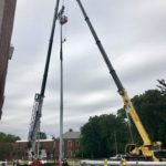 Crofton Crane Rental & Rigging's 165-ton Grove setting a light tower.