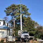 Crofton Crane Rental & Rigging's 40-ton Manitex removing tree at residence.